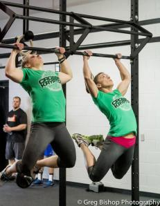 Christy and I doing pull-ups during Team Hammer. Copyright Greg Bishop Photography